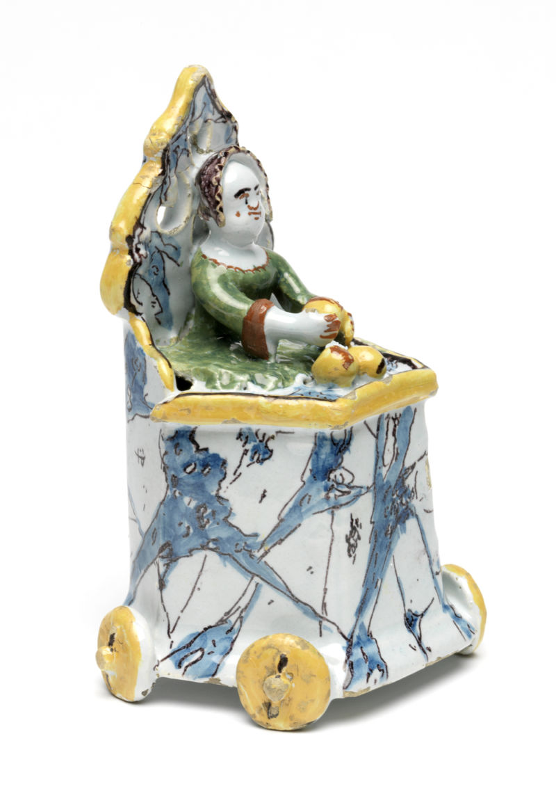 Toddler with fruit in a mobile high chair, probably Die Porceleyne Schotel Factory, Delft, Netherlands, c.1764–73. Tin-glazed earthenware. 13 x 8.3 cm. Dr J.W.L. Glaisher Bequest (C.2773-1928). Image courtesy of The Fitzwilliam Museum.